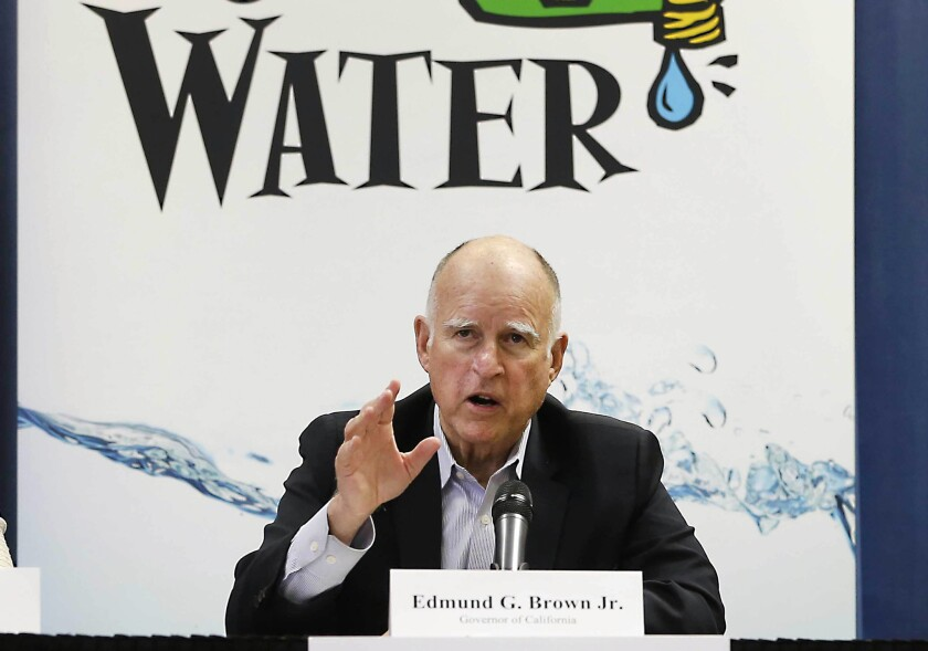 Gov. Jerry Brown talks with reporters in April after a meeting about the drought at his Capitol office in Sacramento.
