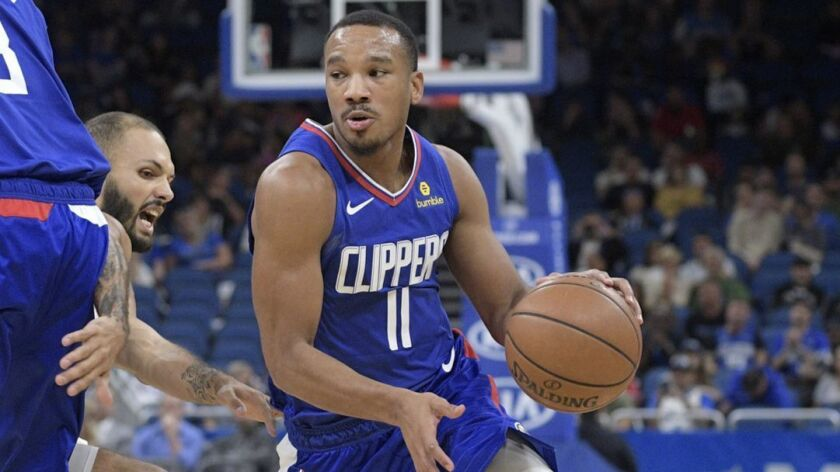 Los Angeles Clippers guard Avery Bradley (11) drives to the basket as forward Danilo Gallinari (8) b