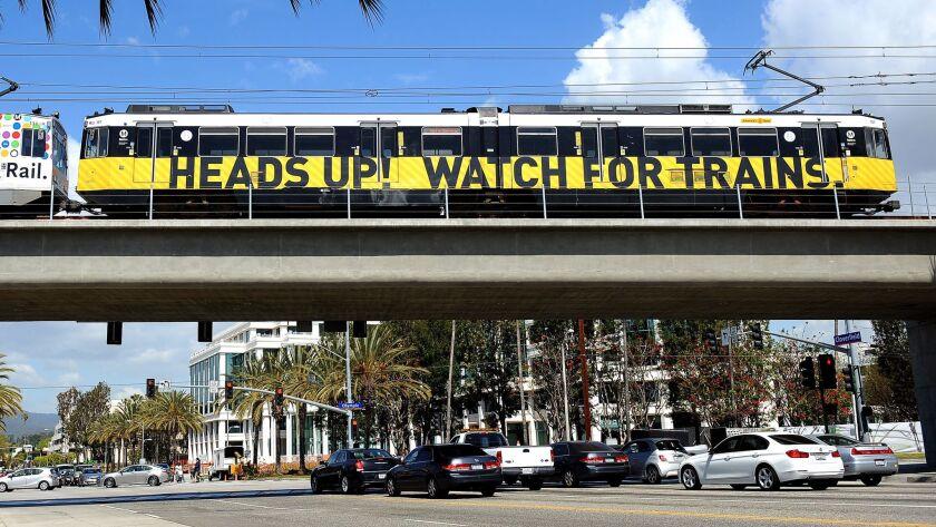 A train crosses a bridge to the 26th Street/Bergamot station in Santa Monica.