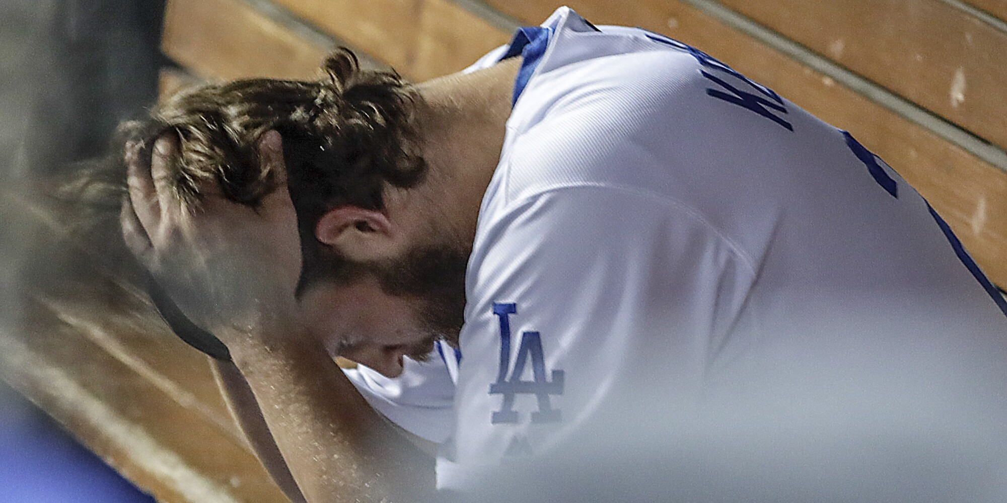 Clayton Kershaw in the dugout after giving up consecutive homers in the 8th inning in game 5 of the National League Division Series at Dodger Stadium.