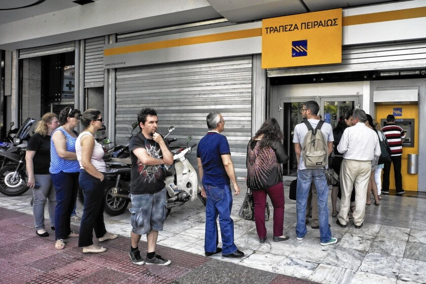 Investors hammered the Greek debt Monday, the first trading day after the call for a referendum. The yield, or interest rate, on its 10-year bond rose more than four full percentage points to 14.68%. Above, Greeks wait to withdraw cash Monday.