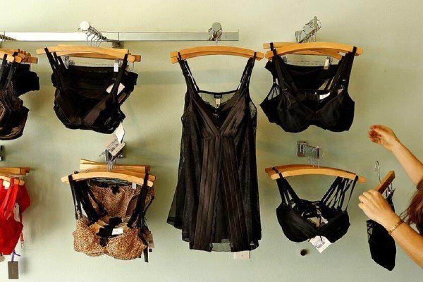 Owner Jen Abercrombie straightens up racks at her lingerie shop, Panty Raid, in Los Feliz.
