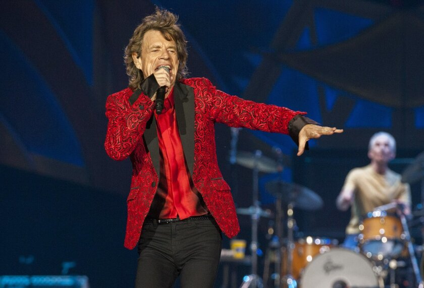 FILE - In this July 4, 2015 file photo, Mick Jagger of the Rolling Stones performs at the Indianapolis Motor Speedway in Indianapolis, Ind. Jagger's representatives say the rock legend is expecting his eighth child. The representatives confirmed a report by People magazine and other media outlets that Jagger's girlfriend, Melanie Hamrick, 29, is pregnant. (Photo by Barry Brecheisen/Invision/AP, File)