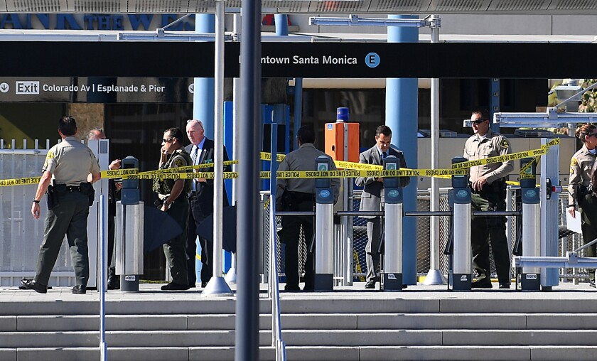 Authorities investigate the Expo Line station in Santa Monica, where on Oct. 4 Thomas Napack allegedly charged toward two deputies, one of whom shot Napack.