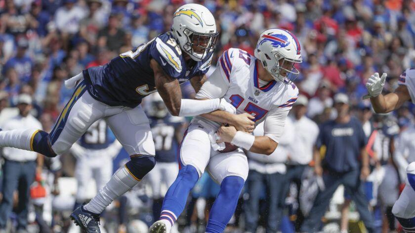 Chargers safety Derwin James sacks Bills quarterback Josh Allen.