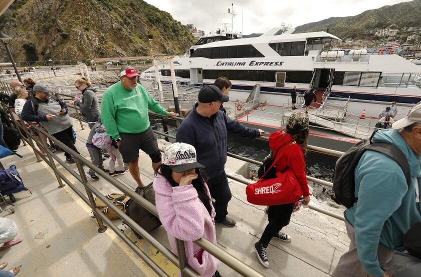 Passengers wait to board a Catalina Express vessel on Catalina Island.