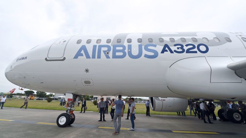 An A320neo passenger plane leaves its hangar at the Airbus plant in St.-Martin-du-Touch, near Toulouse, France.