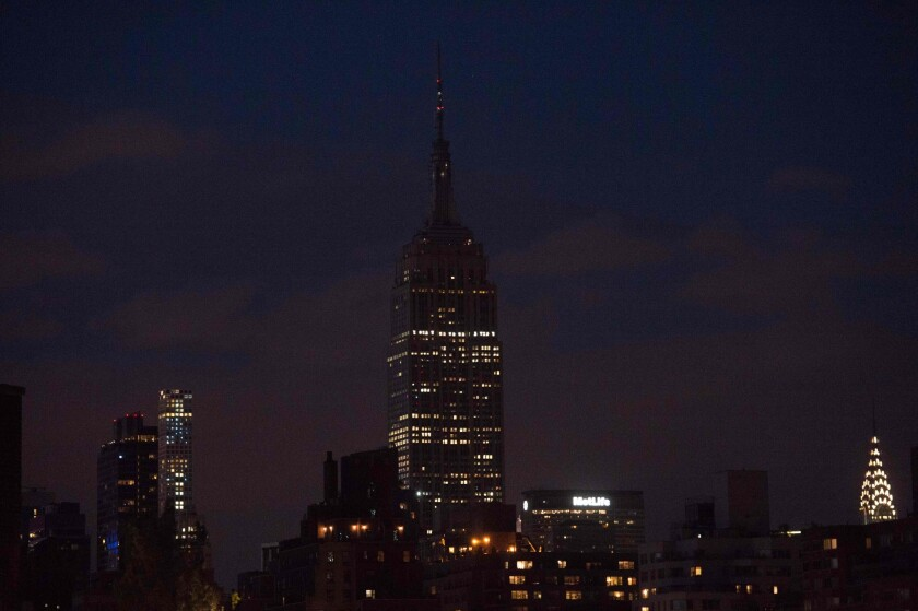 The Empire State Building in New York goes dark in reaction to the Orlando mass shooting.