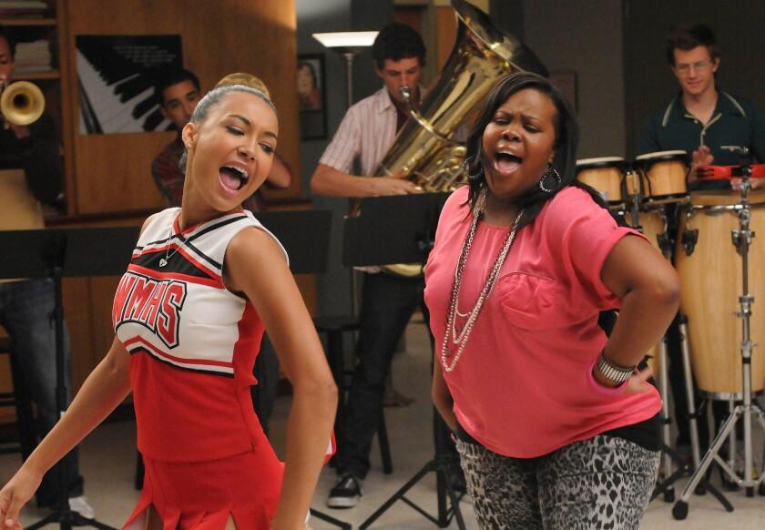 Naya Rivera as Santana, left, and Amber Riley as Mercedes