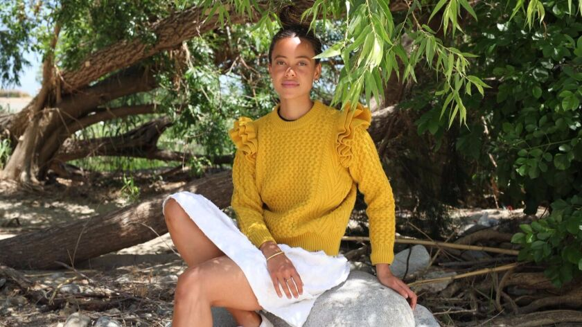 Demy Lee x Clare V.'s Nora sweater with shoulder ruffle detail, $325, available at www.clarev.com and demylee.com.