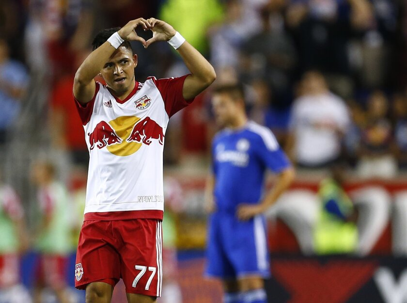 New York Red Bulls midfielder Franklin Castellanos (77) gestures after scoring a goal against Chelsea FC in the second half during a soccer match in the International Champions Cup in Harrison N.J., Wednesday, July 22, 2015. The Red Bulls defeated Chelsea 4-2. (AP Photo/Rich Schultz)