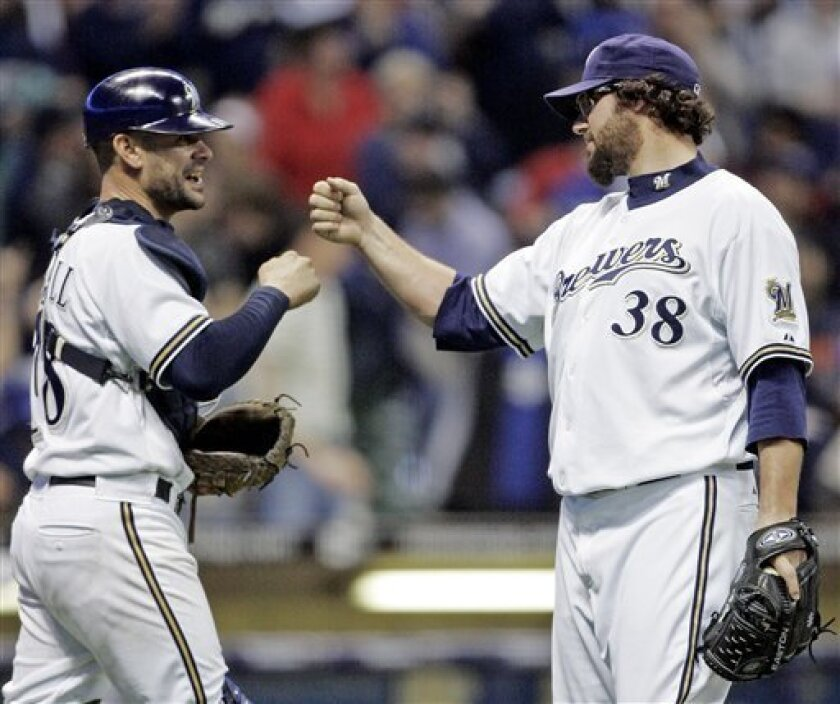 Milwaukee Brewers relief pitcher Eric Gagne (38) is congratulated by catcher Jason Kendall after the ninth inning of a baseball game against the Los Angeles Dodgers Tuesday, May 13, 2008, in Milwaukee. Gagne picked up a save as the Brewers won 5-3. (AP Photo/Morry Gash)