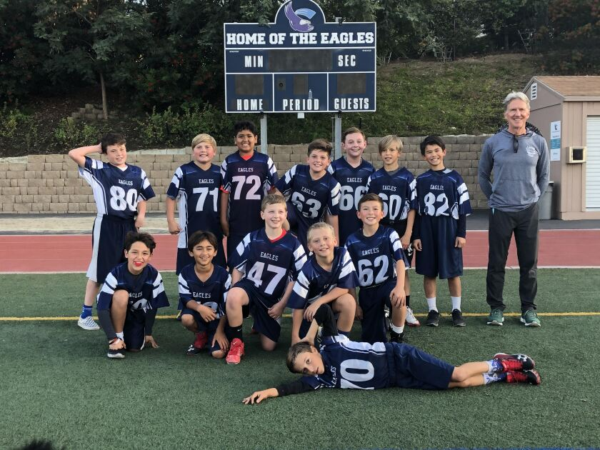 The undefeated R. Roger Rowe School fifth grade football team.