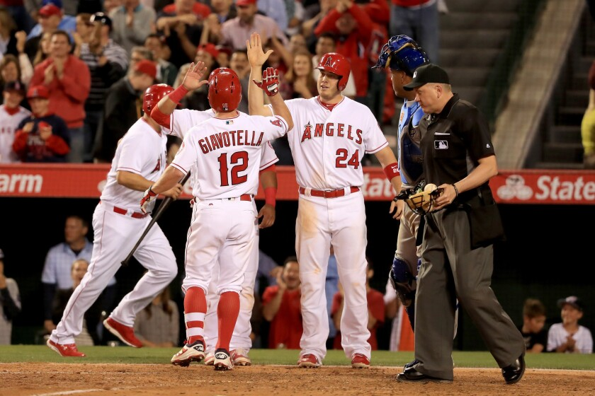 Angels' Johnny Giavotella hits a three-run homer in victory over Royals, 9-4