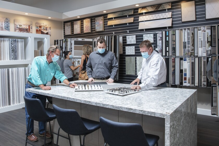 The Jackson Design & Remodeling team guides visitors on a private tour of the company's newly remodeled showroom.