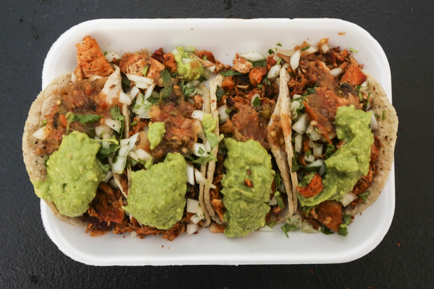 Chicken tacos with cilantro, onions and avocado from Carlos's Tijuana Tacos, a new taco vendor in Whittier.