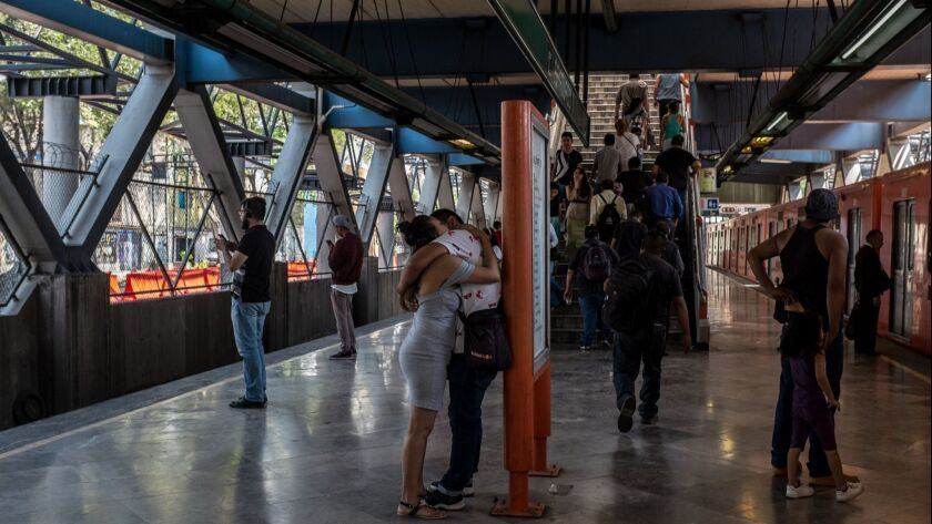 March 24, 2019 - A couple embraces at the Apatlaco stop of Mexico City's metro. The metro, like most