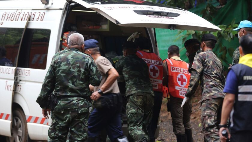 Thai authorities place a boy in an ambulance after he was rescued from Tham Luang Nang Non cave. His condition will be closely monitored, health officials say.