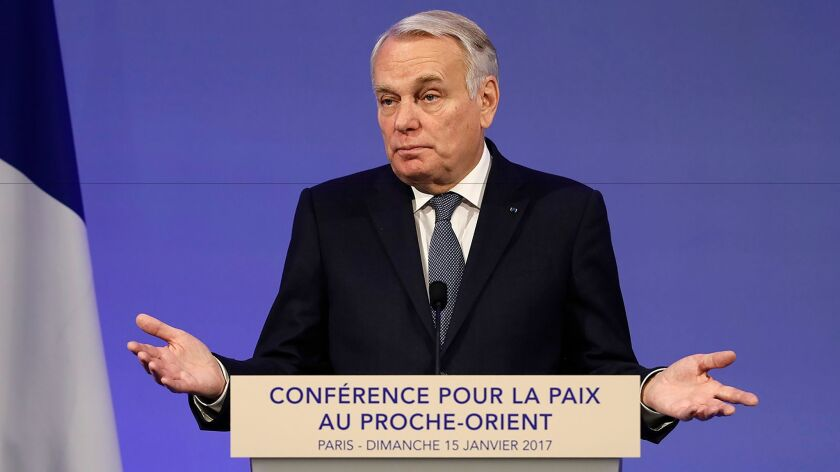 French Minister of Foreign Affairs Jean-Marc Ayrault addresses delegates at the opening of the Mideast peace conference in Paris on Jan. 15, 2017.