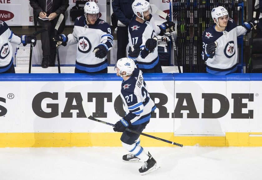Winnipeg Jets' Nikolaj Ehlers (27) celebrate a goal against the Calgary Flames during the third period of an NHL hockey playoff game Monday, Aug. 3, 2020 in Edmonton, Alberta. (Jason Franson/The Canadian Press via AP)