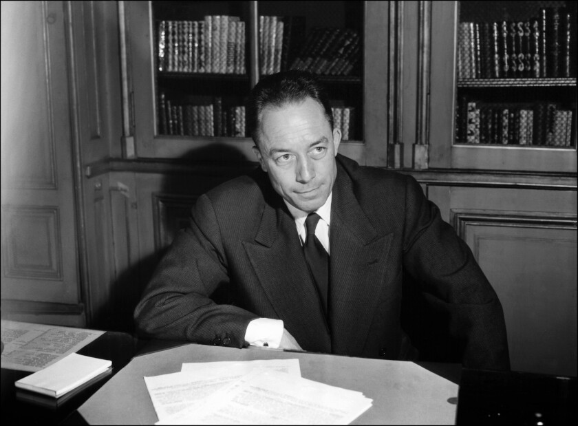 French writer Albert Camus is seen posing for a portrait in Paris.