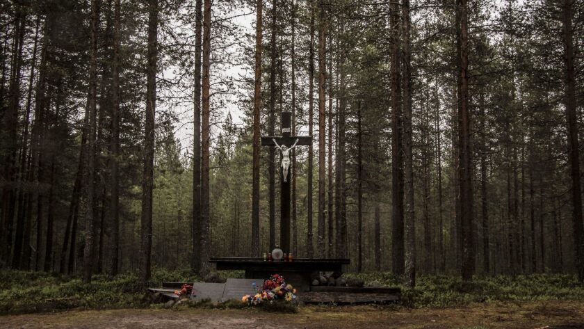 A Catholic cross at Sandarmokh commemorates the Poles who fell victim to Soviet political repression
