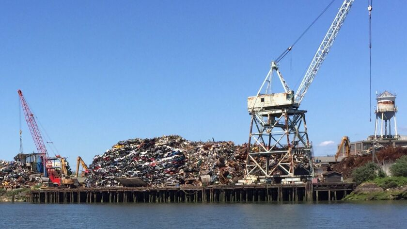 A scrap metal operation on the bank of the Duwamish River.
