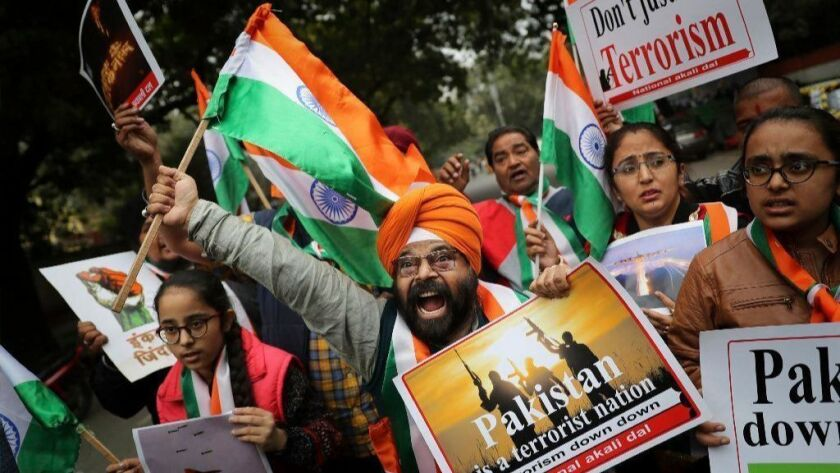 Indians shout anti-Pakistan slogans at a Feb. 26 demonstration in New Delhi following news of Indian aircraft bombing Pakistan territory.