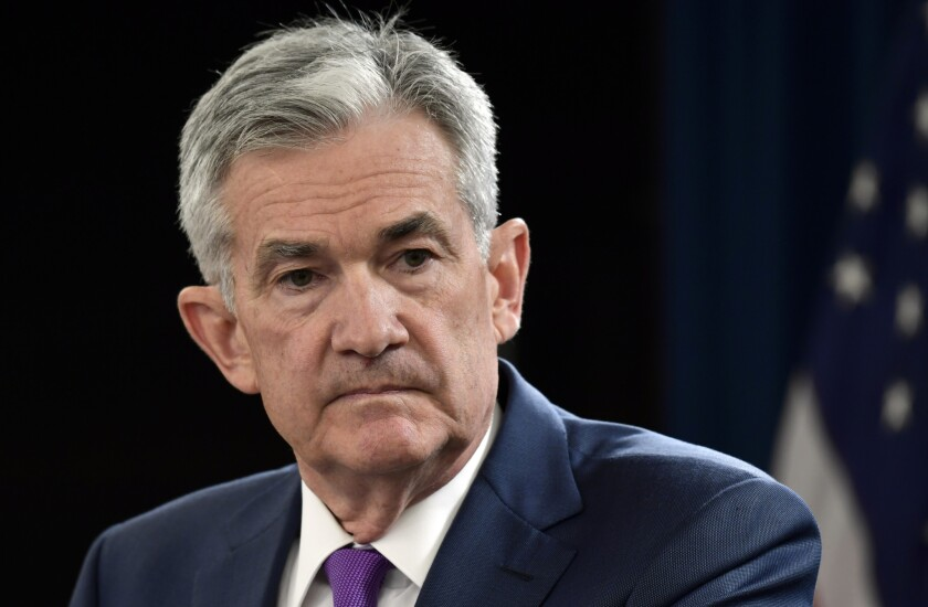 Federal Reserve Chairman Jerome H. Powell, listening to a question at a September news conference in Washington, has been a frequent target of President Trump's attacks.