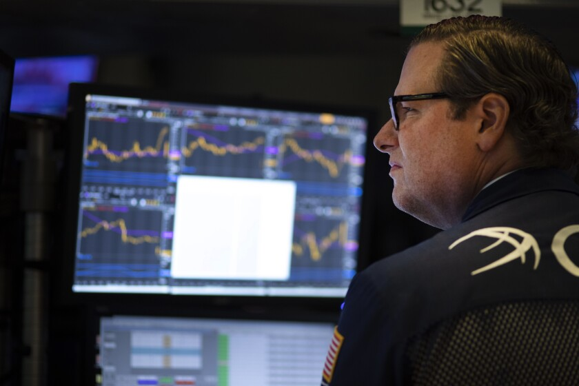 FILE - In this Sept. 18, 2019, file photo a stock trader works at the New York Stock Exchange. The U.S. stock market opens at 9:30 a.m. EDT on Wednesday, Sept. 25. (AP Photo/Mark Lennihan, File)