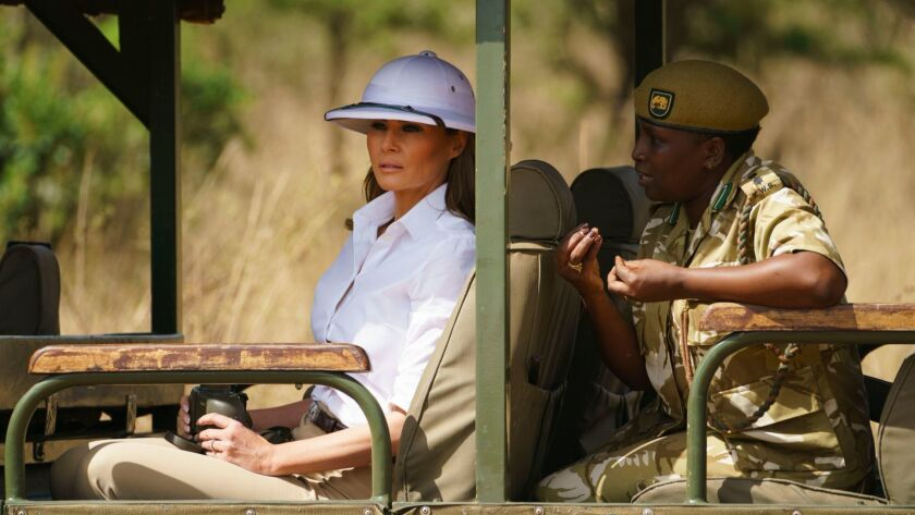 First Lady Melania Trump looks out over Nairobi National Park in Nairobi, Kenya, during a safari guided by park manager Nelly Palmeris.
