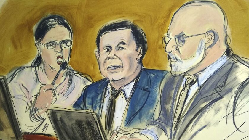 "In a courtroom drawing, Joaquin ""El Chapo"" Guzman, center, sits at the defense table Thursday and listens to U.S. District Judge Brian Cogan address the jury. With him are an interpreter, left, and defense attorney Eduardo Balarezo."