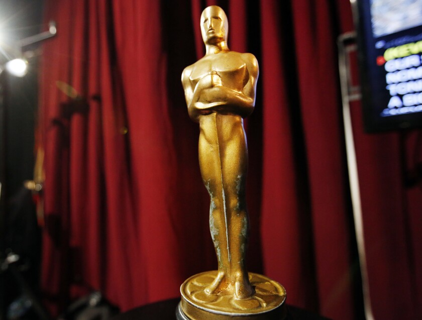 A wooden faux Oscar statue sits backstage at rehearsals in the Dolby Theatre for the 88th Academy Awards.