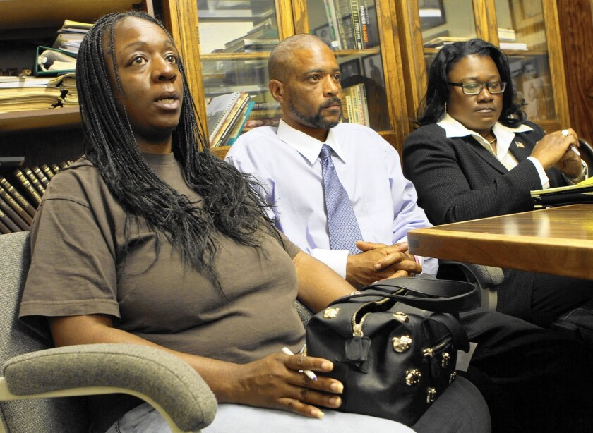 Anya Slaughter, left, and Kenneth McDade, parents of Kendrec McDade, are accompanied by attorney Caree Harper as they speak to the media in 2012 after their son's fatal shooting by Pasadena police.