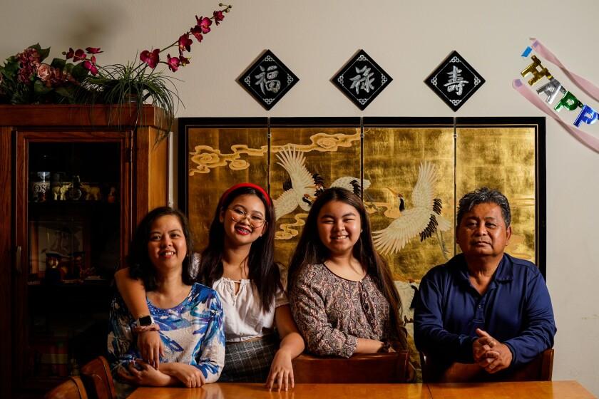 Lien-Chi Cantuba, left, Mai-Chi Nguyen Cantuba, Lan-Chi Nguyen Cantuba and Cesar Cantuba at their home in Eastvale, Calif.
