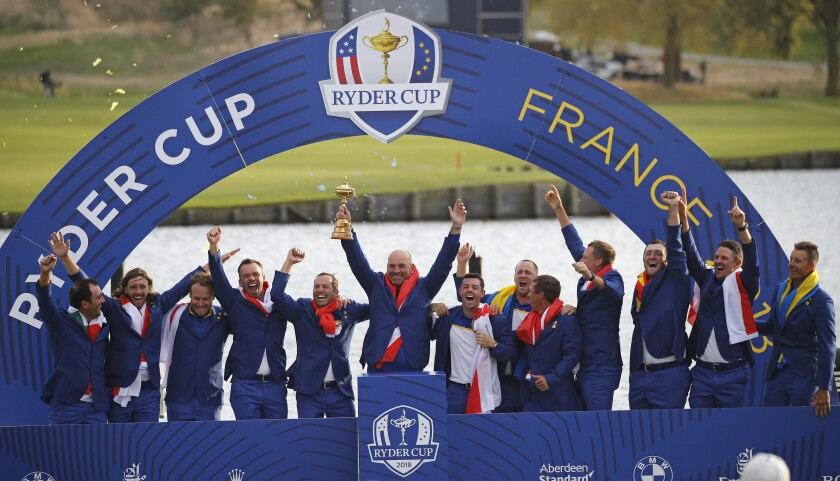 FILE - In this Sept. 30, 2018, file photo, Europe team captain Thomas Bjorn, center, holds the trophy as he celebrates with his team after Europe won the Ryder Cup on the final day of the 42nd Ryder Cup at Le Golf National in Saint-Quentin-en-Yvelines, outside Paris, France. The pandemic-delayed 2020 Ryder Cup returns the United States next week at Whistling Straits along the Wisconsin shores of Lake Michigan. (AP Photo/Francois Mori, File)