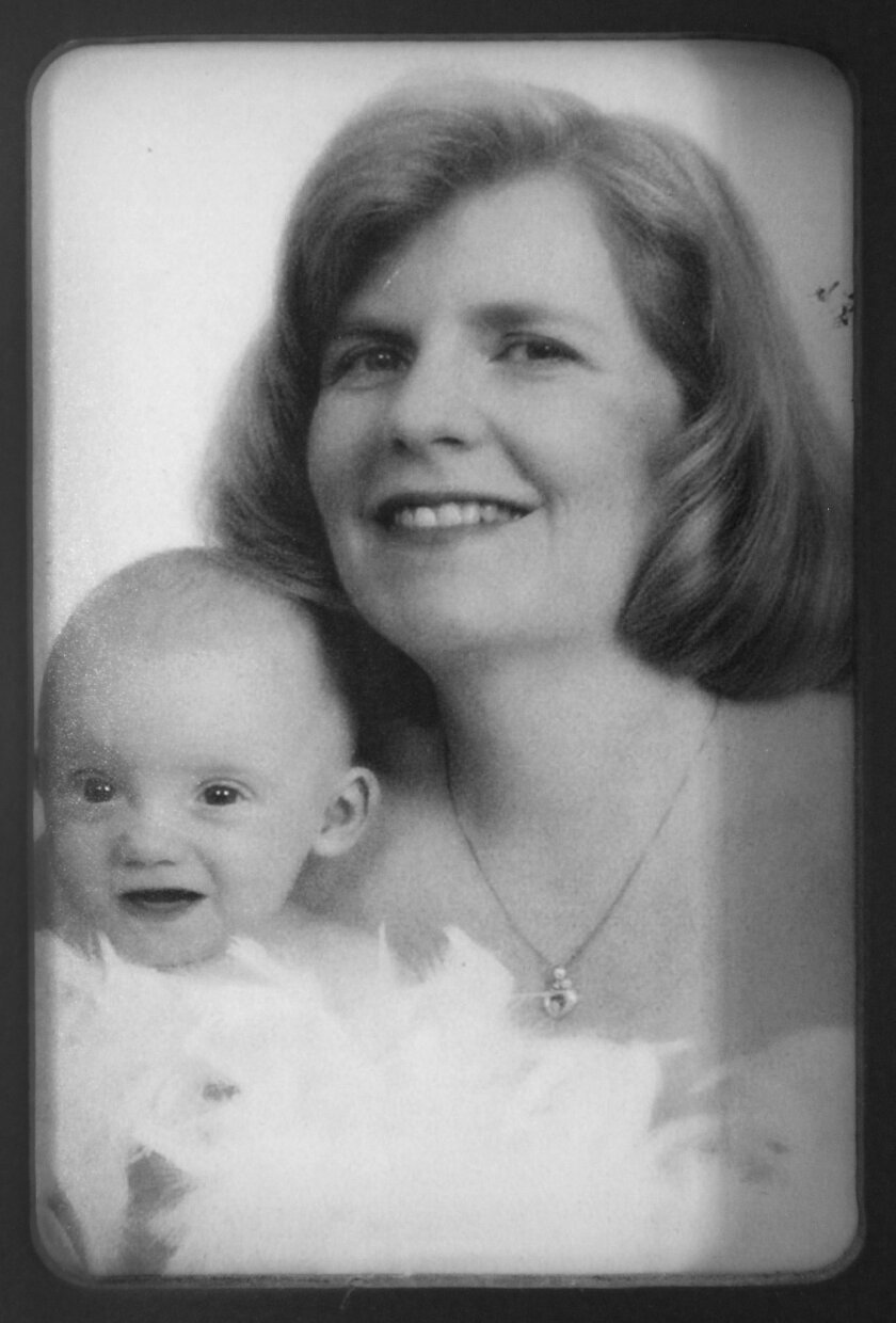 Sam as a baby with his mom, Kathie.