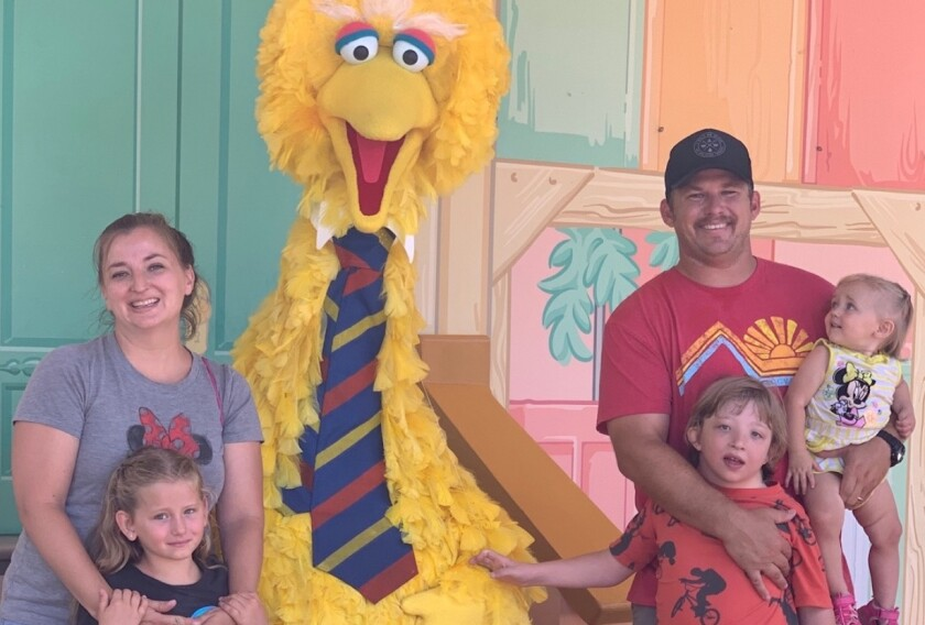Eric Harris with his wife, Kari, their three young children and Big Bird.