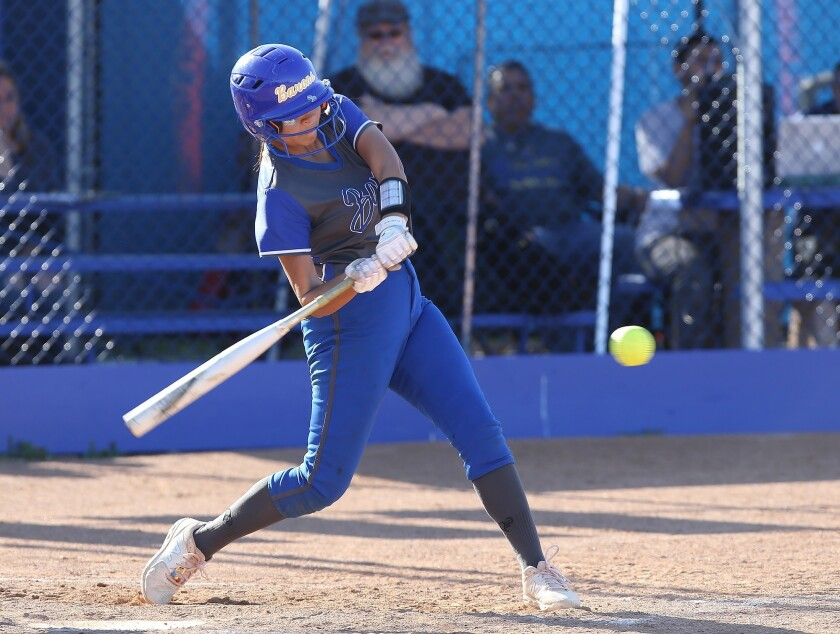 Fountain Valley's Samarta Ortega drives the ball for a hit during Wave League softball game against