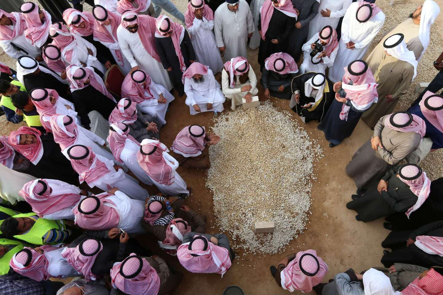 Mourners gather around the grave of Saudi Arabia's King Abdullah at Al Oud cemetery in Riyadh on Jan. 23 following his death in the early hours of the morning.