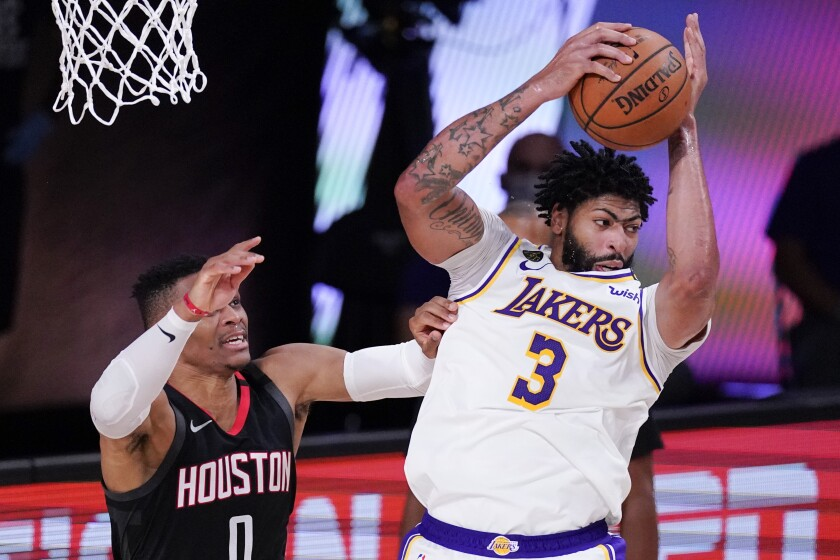 Lakers forward Anthony Davis grabs a rebound over the Rockets guard Russell Westbrook during the second half of Game 5.