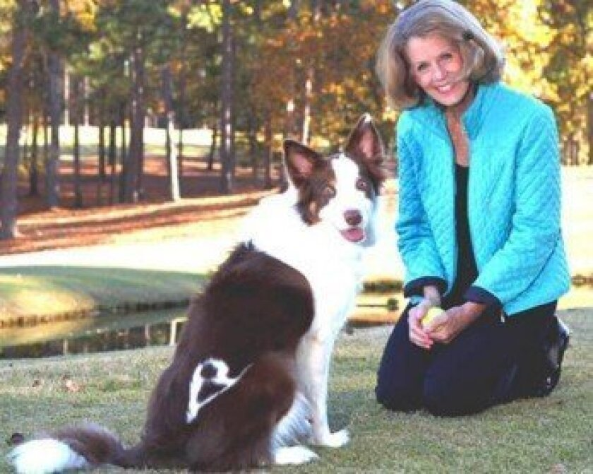 """Animal medium Brent Atwater and 'Friend,' her dog, who sports a """"B"""" on his bottom. Atwater is donating readings at a Readings for Rescue fundraiser at the Helen Woodward Animal Center on Aug. 23."""