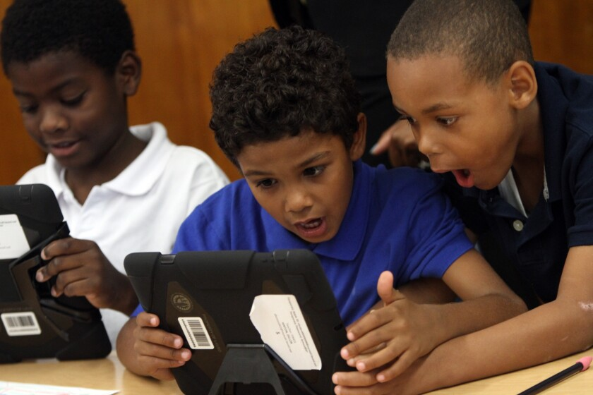 Students at Broadacres Elementary school in Carson explore the possibilities with their new LAUSD provided iPads in August. The district wants to tap about $1 billion in bond money to provide every student, teacher and administrator with a digital tablet.