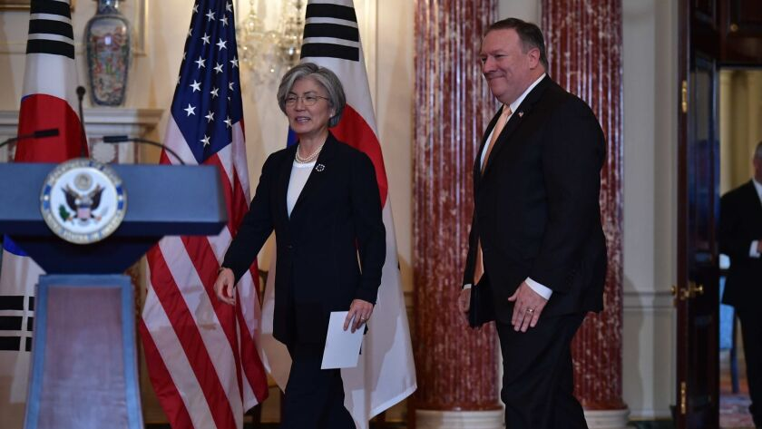 U.S. Secretary of State Mike Pompeo and South Korean Foreign Minister Kang Kyung-wha arrive at a joint news conference at the State Department on Friday.