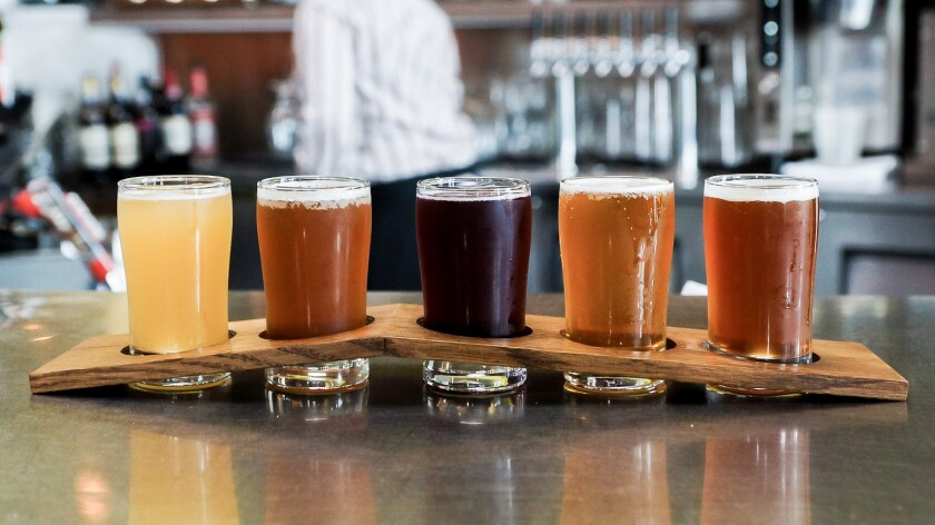 "A tasting flight of beers is shown. Try your hand at matching adjectives such as ""dry"" and ""creamy"" with them."