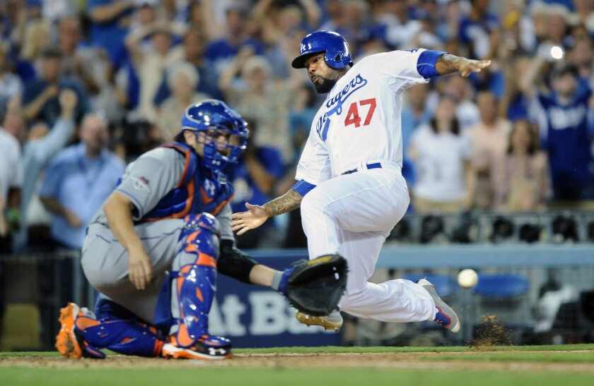 Dodgers second baseman Howie Kendrick beats the throw to Mets catcher Travis d'Arnaud in the seventh inning of Game 2 of the NLDS. The Dodgers beat the Mets, 5-2.