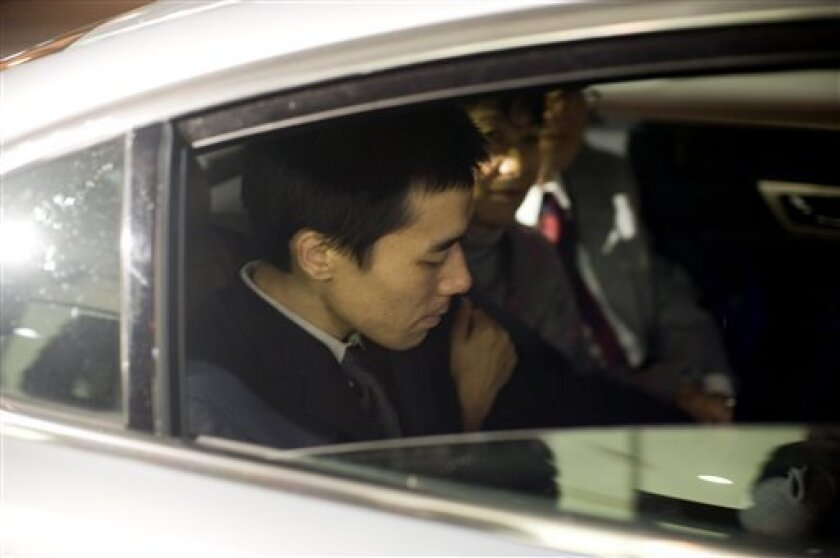 U.S. Missionary Robert Park sits in a car with his mother and father following his return to the U.S. at the to the Los Angeles International Airport on Saturday, Feb. 06, 2010. Park was detained in North Korea after crossing the border from China on Christmas Day. (AP Photo/David Zentz)