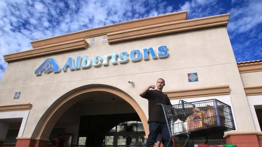 Regulators sue Albertsons for allegedly banning employees