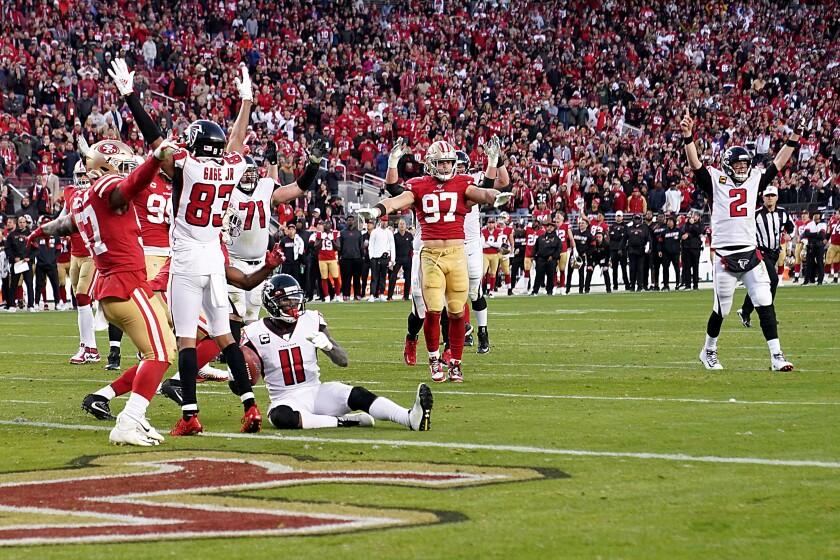 Atlanta Falcons quarterback Matt Ryan celebrates after connecting with wide receiver Julio Jones on a touchdown pass.