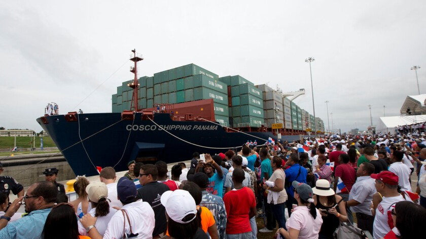 A cargo ship begins to cross the new Agua Clara locks, part of the Panama Canal expansion project, n
